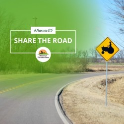 Missouri Farmers Care Text with Tractor Road Sign and Road